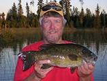 Ontario_fly-in_Bass_Fishing - Treelined_Lake